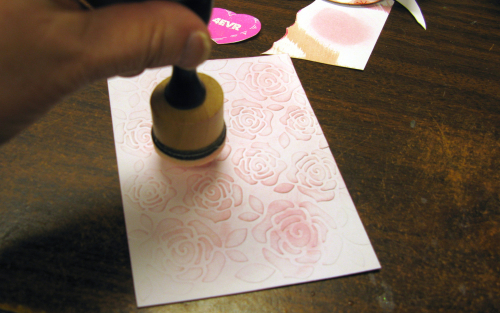 Putting distress ink on embossed surface